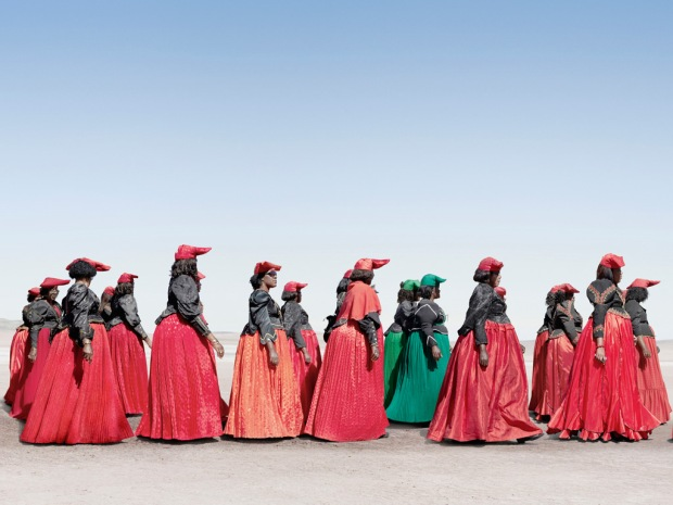 Herero women tribe in costumes marching, Namibia
